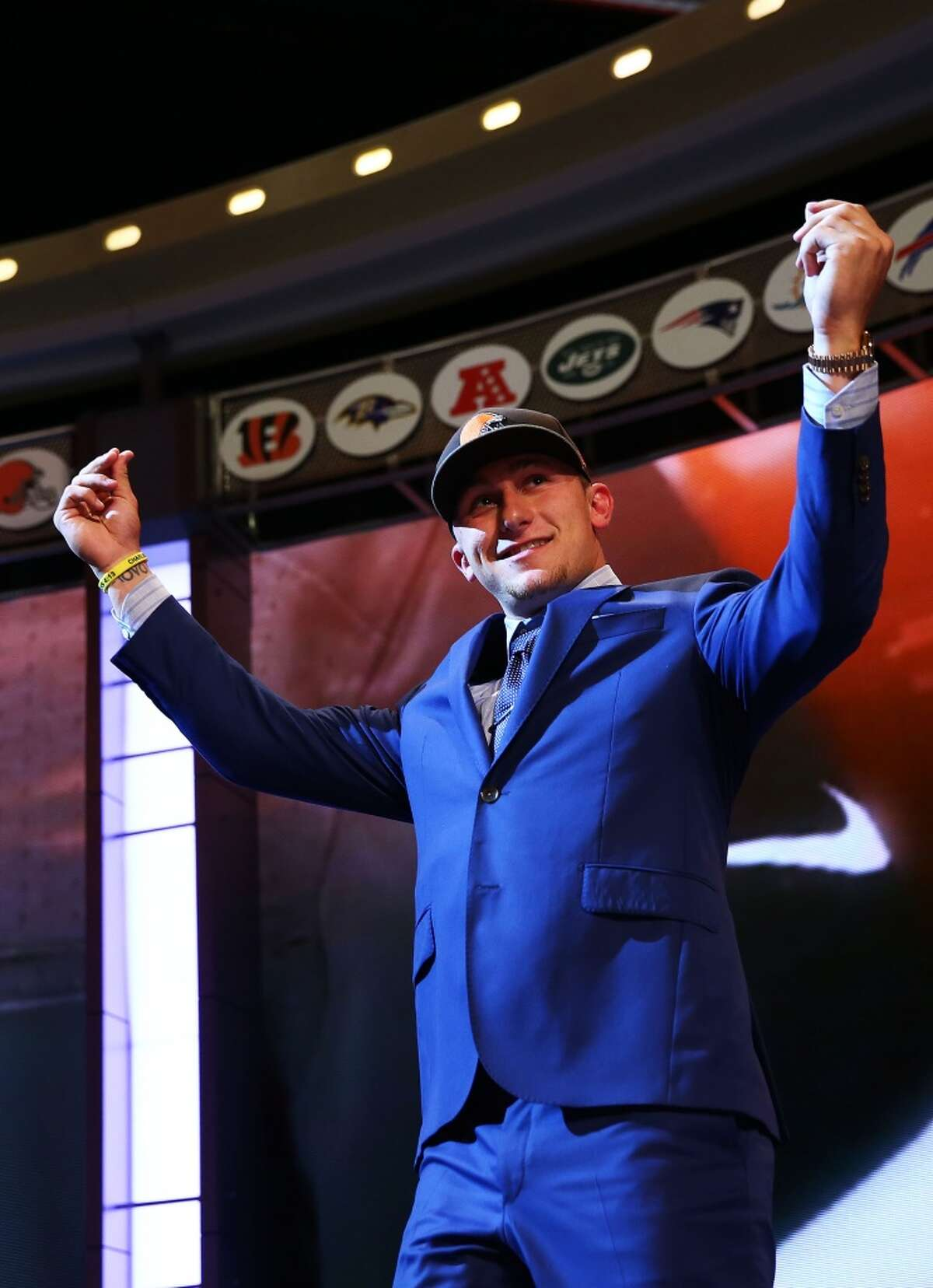 Johnny Manziel of the Texas A&M Aggies takes the stage after he was picked #22 overall by the Cleveland Browns during the first round of the 2014 NFL Draft at Radio City Music Hall on May 8, 2014 in New York City.