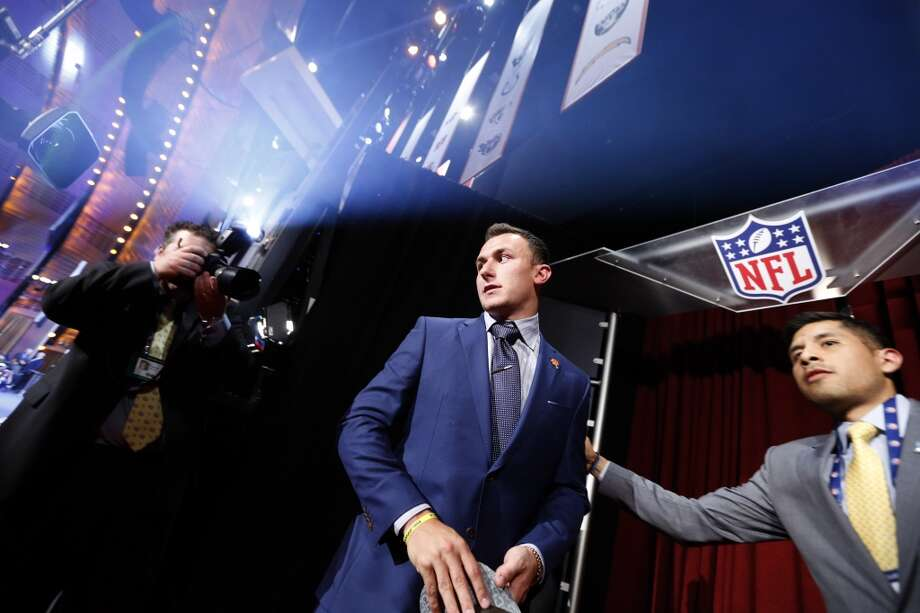 Johnny Manziel, from Texas A&M, walks onstage after being selected 22nd overall by the Cleveland Browns during the first round of the NFL football draft, Thursday, May 8, 2014, at Radio City Music Hall in New York. Photo: Jason DeCrow, Associated Press