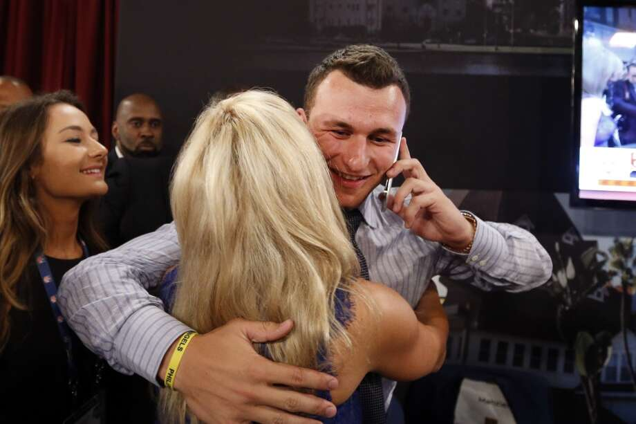 Johnny Manziel, from Texas A&M, reacts after being selected 22nd overall by the Cleveland Browns during the first round of the NFL football draft, Thursday, May 8, 2014, at Radio City Music Hall in New York. Photo: Jason DeCrow, Associated Press
