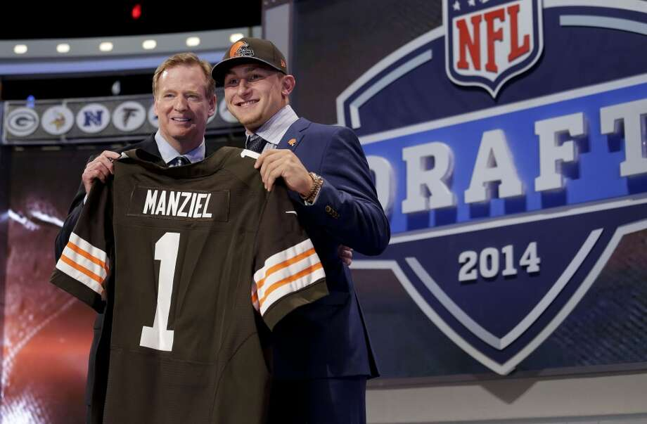 Texas A&M quarterback Johnny Manziel poses with NFL commissioner Roger Goodell after being selected by the Cleveland Browns as the 22nd pick in the first round of the 2014 NFL Draft, Thursday, May 8, 2014, in New York. Photo: Craig Ruttle, Associated Press