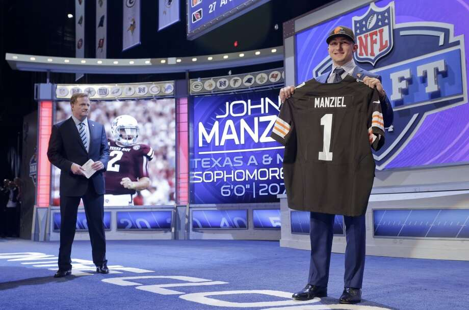 Texas A&M quarterback Johnny Manziel poses for photos after being selected by the Cleveland Browns as the 22nd pick in the first round of the 2014 NFL Draft, Thursday, May 8, 2014, in New York. Photo: Craig Ruttle, Associated Press
