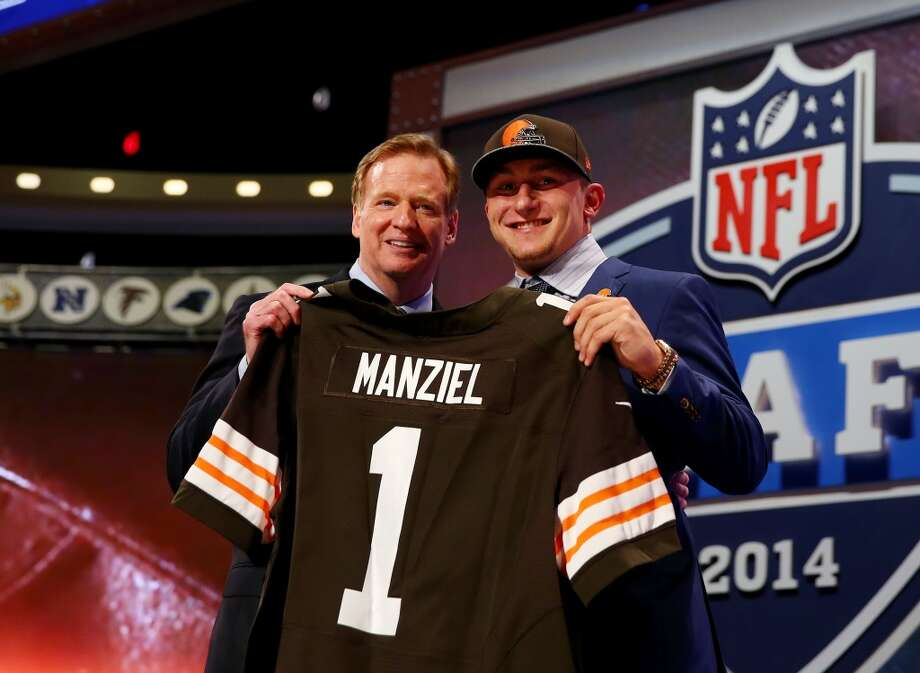 Johnny Manziel of the Texas A&M Aggies poses with NFL Commissioner Roger Goodell after he was picked #22 overall by the Cleveland Browns during the first round of the 2014 NFL Draft at Radio City Music Hall on May 8, 2014 in New York City. Photo: Elsa, Getty Images