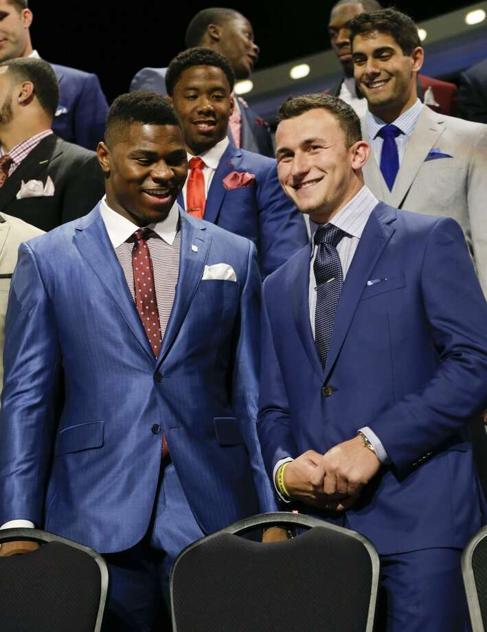 Buffalo Khalil Mack, left, greets Texas A&M quarterback Johnny Manziel as they are introduced during the first round of the 2014 NFL Draft, Thursday, May 8, 2014, in New York. Photo: Frank Franklin II, Associated Press