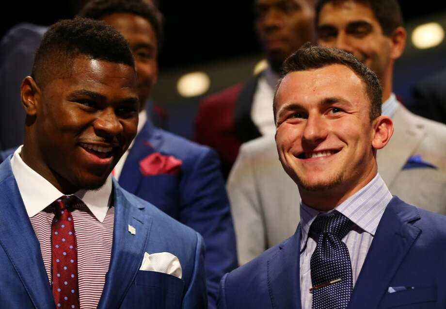 Khalil Mack (L) of the Buffalo Bulls and Johnny Manziel of the Texas A&M Aggies are introduced during the first round of the 2014 NFL Draft at Radio City Music Hall on May 8, 2014 in New York City. Photo: Elsa, Getty Images