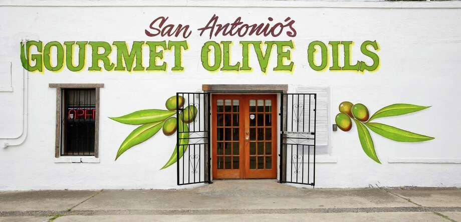 Retired marine Christine Arredondo operates San Antonio's Gourmet Olive Oils on 1913 S. Hackberry. Photo: William Luther, San Antonio Express-News / © 2014 San Antonio Express-News