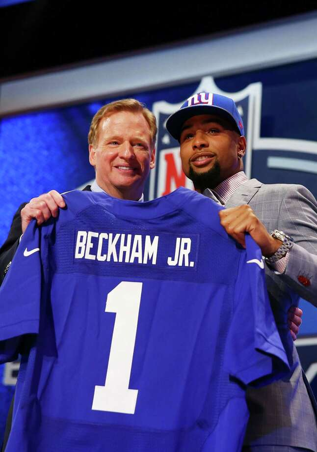 NEW YORK, NY - MAY 08:  Odell Beckham Jr of the LSU Tigers poses with NFL Commissioner Roger Goodell after he was picked #12 overall by the New York Giants during the first round of the 2014 NFL Draft at Radio City Music Hall on May 8, 2014 in New York City.  (Photo by Elsa/Getty Images) ORG XMIT: 484586175 Photo: Elsa / 2014 Getty Images