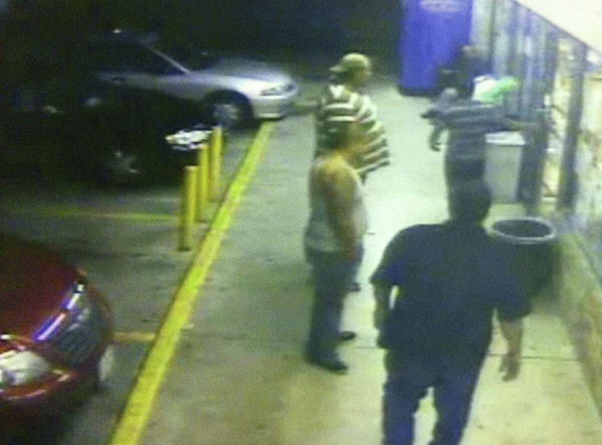 """A security camera still shows Juan """"Johnny"""" Romero attempting to go back inside a convenience store as he is surrounded by the attackers identified by prosecutors."""