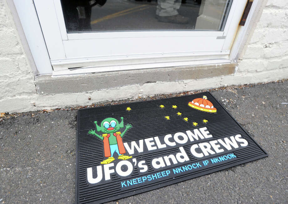 A UFO welcome mat outiside the Connecticut Chapter of MUFON  meeting at the St. Catherine of Siena Church school building in Riverside. Photo: Bob Luckey / Greenwich Time