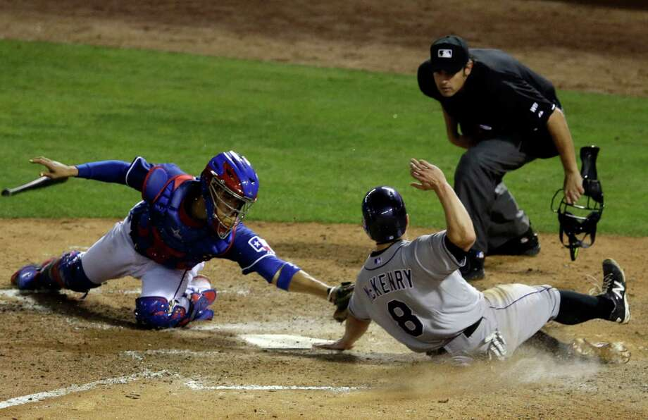 After a scoring deluge the previous three nights, runs were hard to come by for the Rockies on Thursday, with Michael McKenry being tagged out by the Rangers' Robinson Chirinos in the seventh inning. Photo: Tony Gutierrez, STF / AP