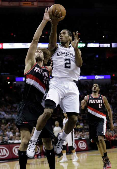 The Spurs' Kawhi Leonard (2) shoots over the Blazers' Robin Lopez for two of his 20 points. Photo: Eric Gay, STF / AP