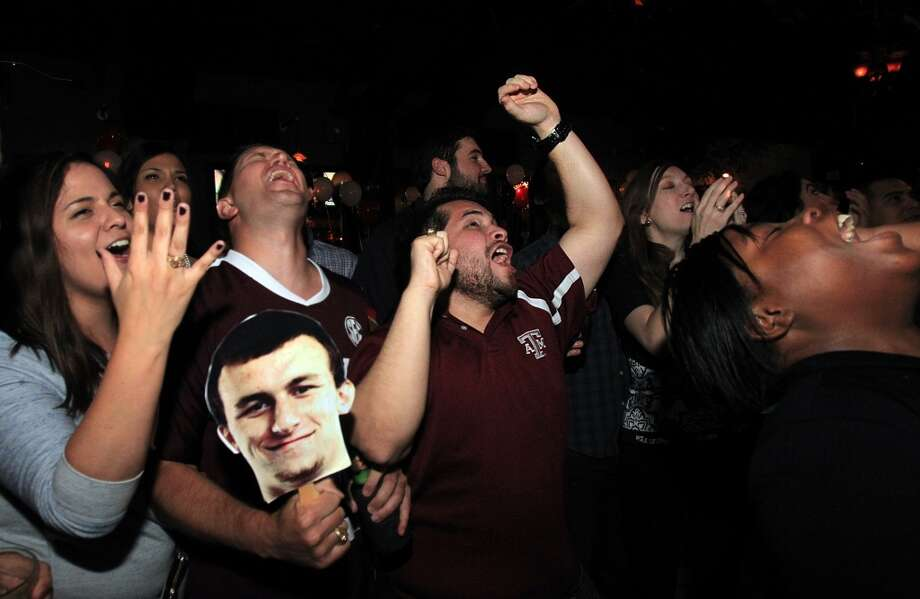 "After what seemed like an eternity, fans at lawyer Tony Buzbee's ""Draft Johnny Manziel"" watch party in Houston didn't look happy.  The No. 22 pick, Manziel is headed to the Cleveland Browns, instead of the Dallas Cowboys. Photo: Mayra Beltran, Houston Chronicle"