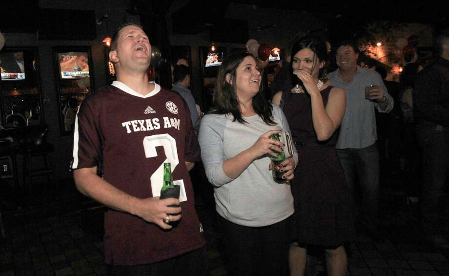 """No!"" yells Clint Holland as Manziel is drafted to Cleveland. Photo: Mayra Beltran, Houston Chronicle"