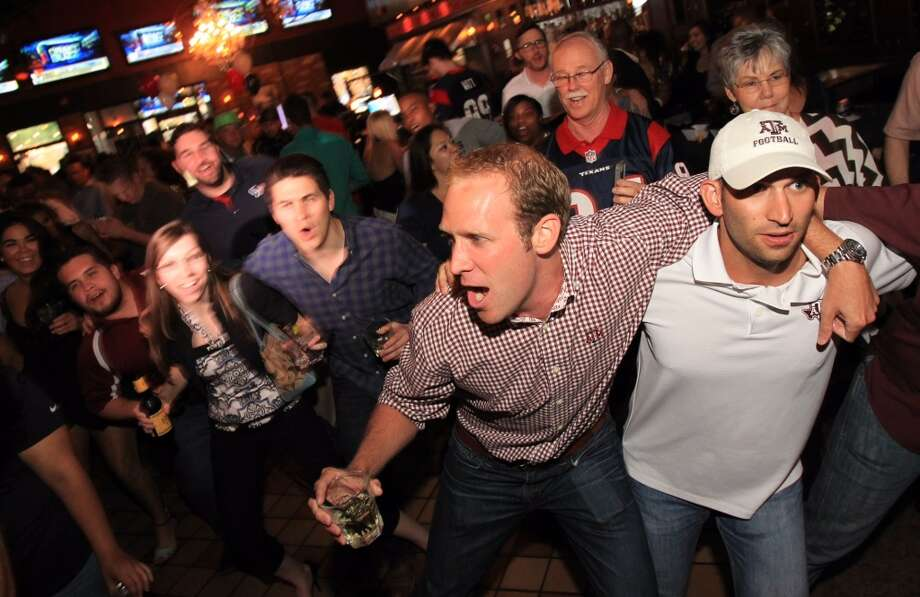 Texas A&M fans sing. The party was hosted by Tony Buzbee, a top Houston lawyer, at Hughes Hangar. Photo: Mayra Beltran , Houston Chronicle
