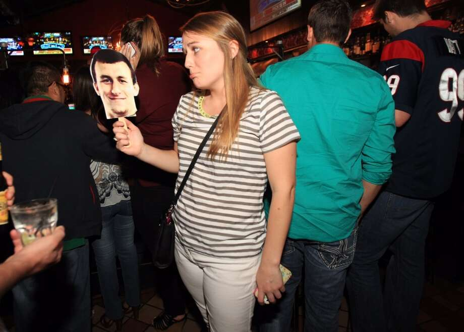 A fan at the Buzbee party looks sad after Manziel is passed up early in the draft. Photo: Mayra Beltran , Houston Chronicle