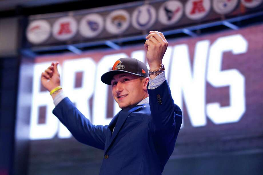After hearing 21 names called before his, Johnny Manziel played to the Cleveland Browns fans present at Radio City Music Hall at the NFL draft, May 8, 2014. Photo: Brett Coomer, Staff / © 2014 Houston Chronicle