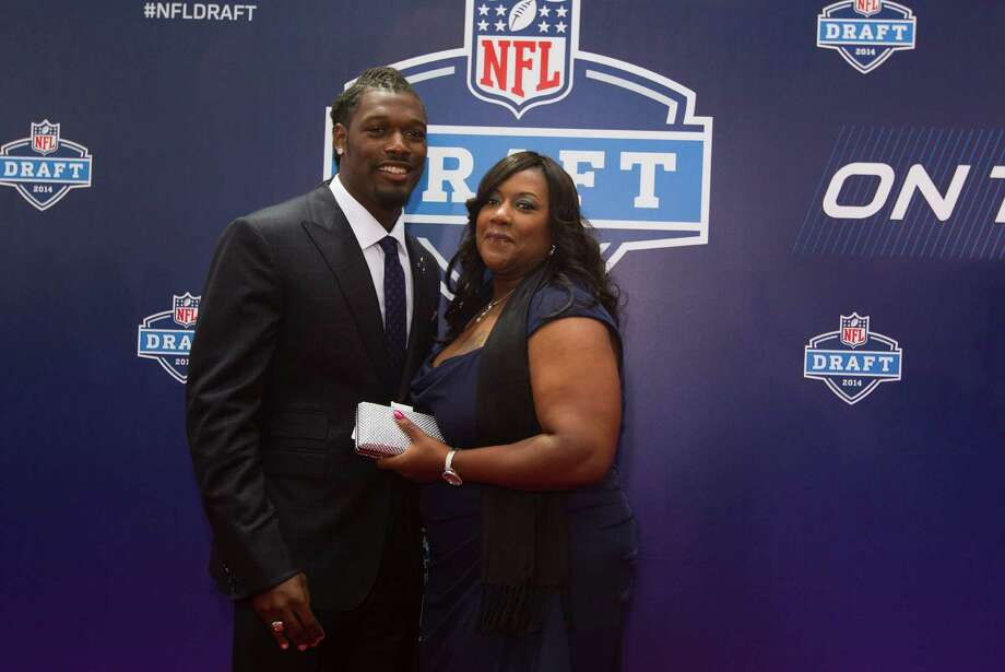 Jadeveon Clowney, of South Carooina, poses for photos with his mother, Josenna, as they arrive to the NFL Draft at Radio City Music Hall Thursday, May 8, 2014, in New York. Photo: Brett Coomer, Houston Chronicle / © 2014 Houston Chronicle
