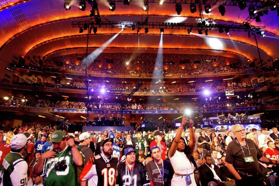 NFL Fans watch the first round of the NFL Draft at Radio City Music Hall Thursday, May 8, 2014, in New York. Photo: Brett Coomer, Houston Chronicle / © 2014 Houston Chronicle