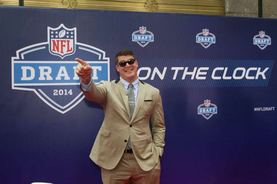 Taylor Lewan, of Michigan, poses for photos on the Red Carpet before the NFL Draft at Radio City Music Hall Thursday, May 8, 2014, in New York. Photo: Brett Coomer, Houston Chronicle / © 2014 Houston Chronicle
