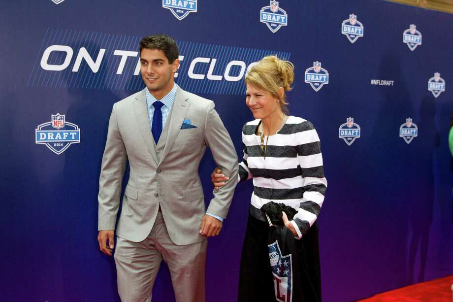 Jimmuy Garoppolo, of Eastern Illinois, walks the Red Carpet with his mother, Denise, before the NFL Draft at Radio City Music Hall Thursday, May 8, 2014, in New York. Photo: Brett Coomer, Houston Chronicle / © 2014 Houston Chronicle