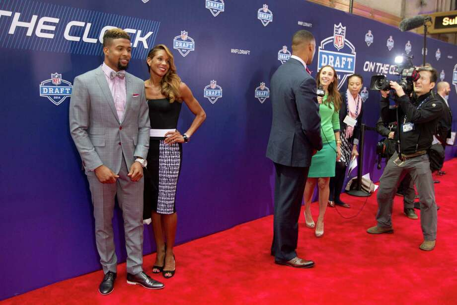 Odell Beckham, Jr., of Louisiana State, poses for photos with his mother, Heather Van Norman, before the NFL Draft at Radio City Music Hall Thursday, May 8, 2014, in New York. Photo: Brett Coomer, Houston Chronicle / © 2014 Houston Chronicle