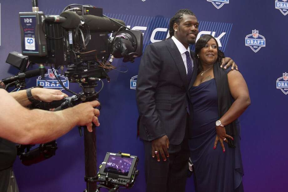 Jadeveon Clowney, of South Carooina, poses for photos with his mother, Josenna, as they arrive to the NFL Draft at Radio City Music Hall Thursday, May 8, 2014, in New York. ( Brett Coomer / Houston Chronicle ) Photo: Brett Coomer, Houston Chronicle