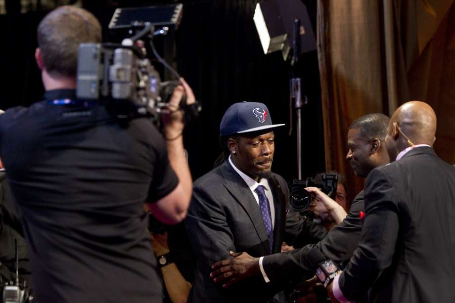 Jadeveon Clowney celebrates as he is selected by the Houston Texans as the No. 1 overall draft pick during the NFL Draft at Radio City Music Hall Thursday, May 8, 2014, in New York. ( Brett Coomer / Houston Chronicle ) Photo: Brett Coomer, Houston Chronicle