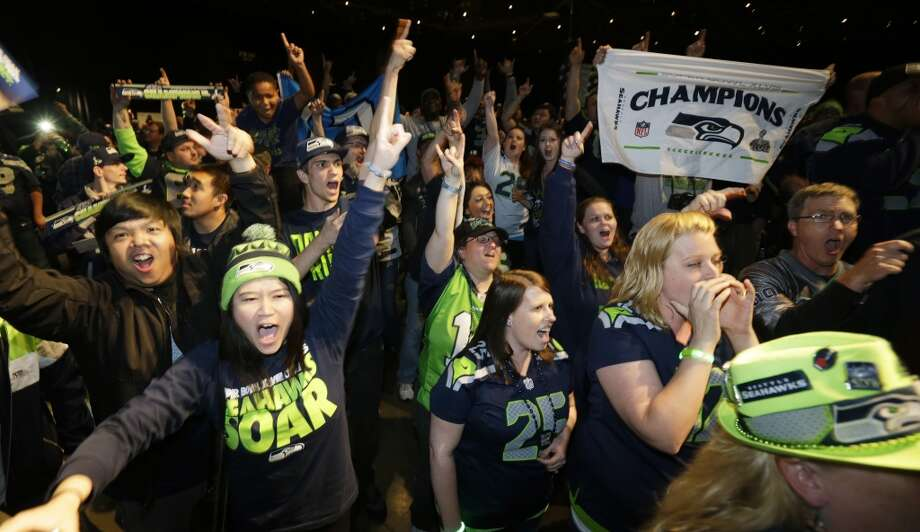Seattle Seahawks fans cheer just before it was announced that the Seahawks traded their 32nd pick in the first round of the NFL football draft to the Minnesota Vikings, Thursday, May 8, 2014 during the Seahawks draft party at the CenturyLink Field Events Center in Seattle. Photo: Ted S. Warren, Associated Press