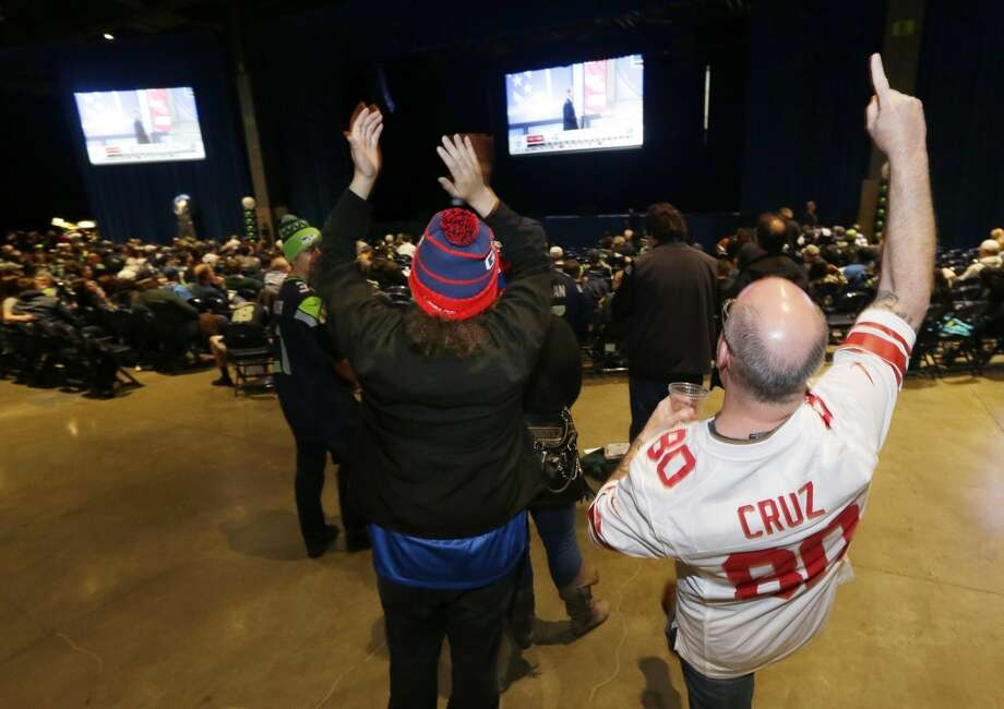 New York Giants fan Greg Greenstein, right, of North Bend, Wash., cheers as he waits to hear that the Giants selected Louisiana State wide receiver Odell Beckham Jr. in the first round of the NFL football draft as he attends the Seattle Seahawks NFL football draft party, Thursday, May 8, 2014 at the CenturyLink Field Events Center in Seattle. Photo: Ted S. Warren, Associated Press