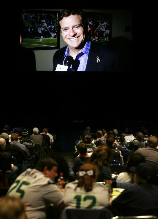Seattle Seahawks general manager John Schneider addresses fans gathered at the Seahawks draft party from a giant video screen, Thursday, May 8, 2014 at the CenturyLink Field Events Center in Seattle. Photo: Ted S. Warren, Associated Press