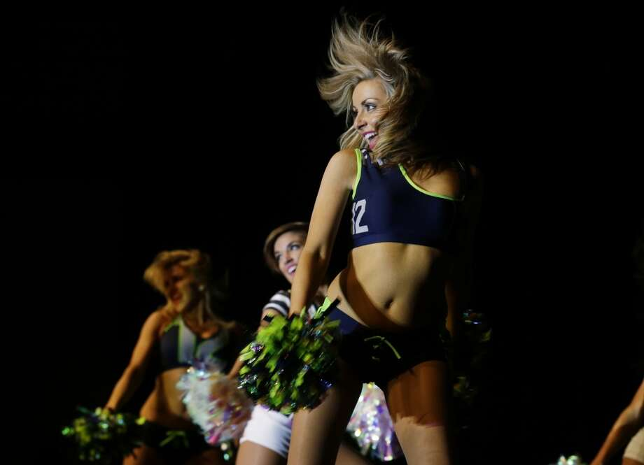 Seattle Seahawks Sea Gals cheerleaders perform at the Seattle Seahawks NFL football draft party, Thursday, May 8, 2014 at the CenturyLink Field Events Center in Seattle. Photo: Ted S. Warren, Associated Press