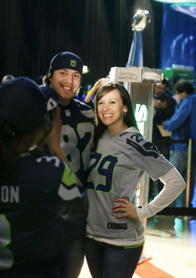 Seattle Seahawks fans pose for a photograph with the Super Bowl Vince Lombardi Trophy as they attend the Seattle Seahawks NFL football draft party, Thursday, May 8, 2014 at the CenturyLink Field Events Center in Seattle. Photo: Ted S. Warren, Associated Press