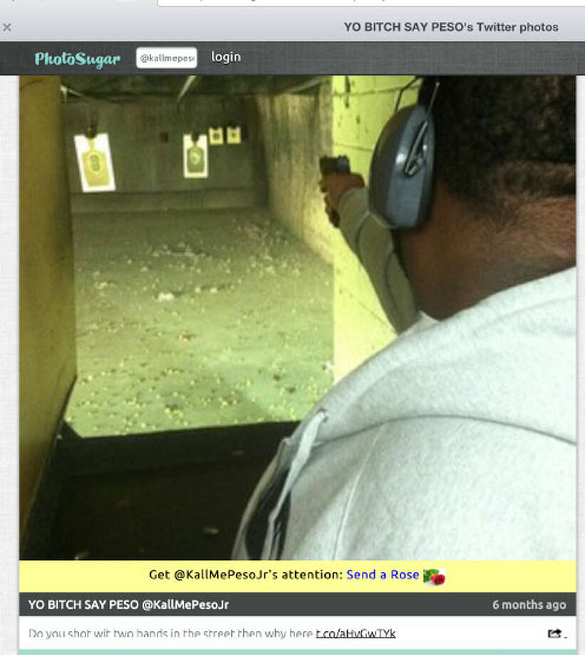 "In this photo taken from KaJuan Ringo's Twitter feed, Ringo is seen firing a handgun. The caption reads: ""Do you shoot wit [sic] two hands in the street then why here."" Photo: Justice Department Photo"