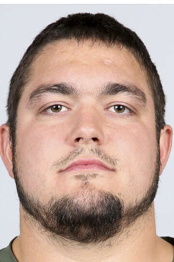 The selection of OL Zack Martin indicates owner Jerry Jones is sticking with Tony Romo at quarterbac