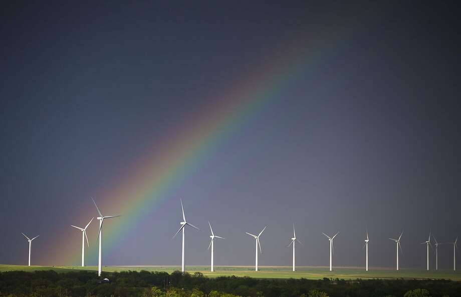 A wind-energy farm grows a rainbow near Latham, Kan. Photo: Travis Heying, Associated Press