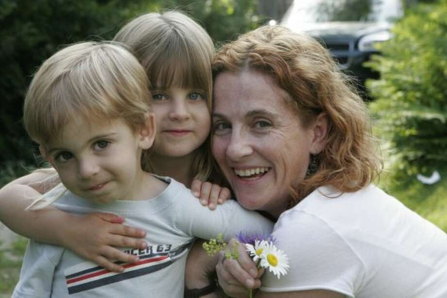 """Ayelet Waldman, author of Love and Treasure, and mother of Sophie, 19, Zeke, 16, Rosie, 12, Abe 11. Best parenting advice: """"Perfection is impossible. There will be days when your children's chins are dyed orange with Cheetoe dust, when your voice will be hoarse from having yelled, when you've relied on the comforts of Disney rather than the bracing stimulation of an educational game. The only thing I've learned in more than 19 years of motherhood is that failure is inevitable. We must forgive ourselves and try to remember that our goal is not to be perfect, but simply good enough."""" Photo: Patricia Williams"""