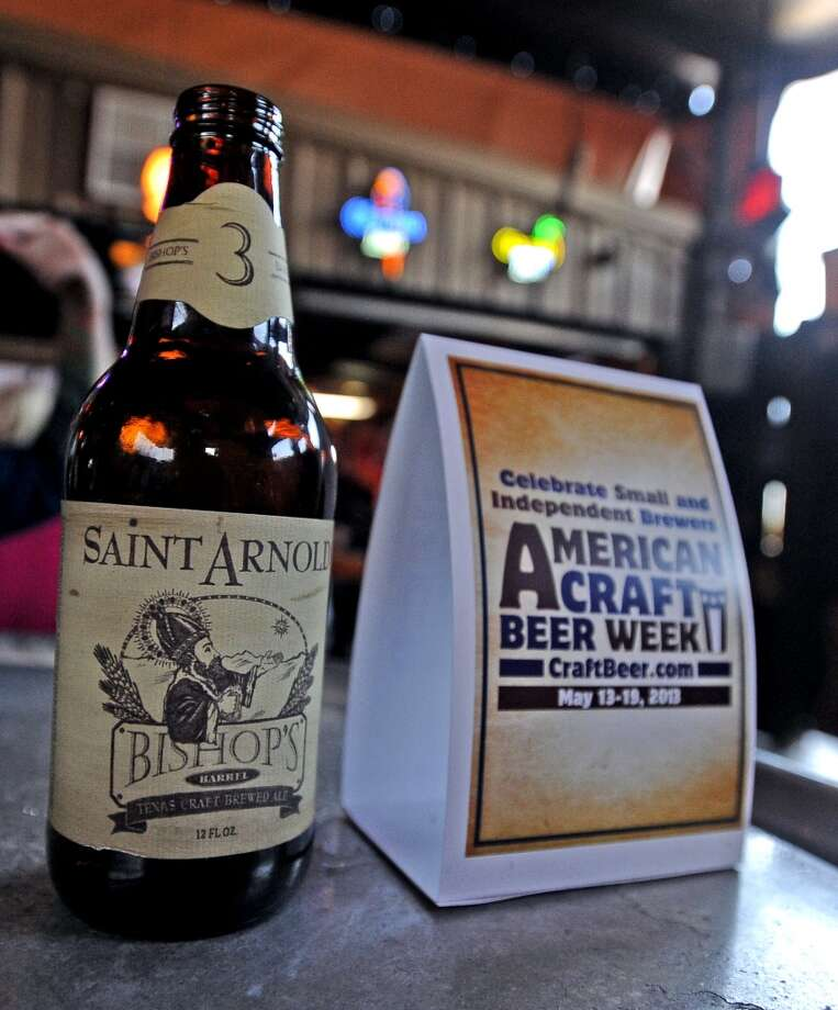 The last bottle of Saint Arnold Bishop Barrel 3 sold for American Craft Beer Week at Madison's on Tuesday, May 14, 2013. Photo taken: Randy Edwards/The Enterprise