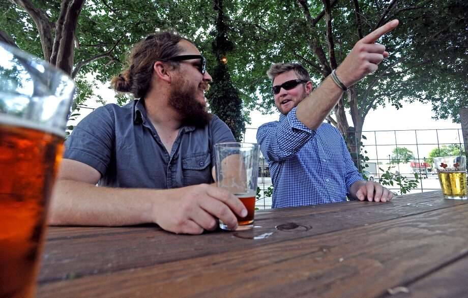 Wes Hardin, left, and Tyler Blount, right, talk beer during American Craft Beer Week at Luke's on Wednesday, May 16, 2013. Photo taken: Randy Edwards/The Enterprise