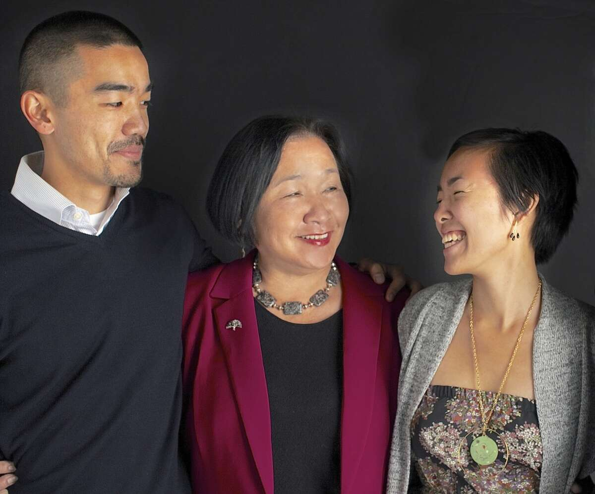 Oakland Mayor Jean Quan with her son William Huen, 36, and daughter, Lailan Huen, 32. Best parenting advice: