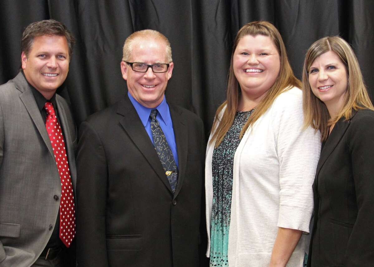 Lawhon Elementary's Taresa Jacobsen and Dawson High School's Mark Lesmeister won the elementary and secondary Teacher of the Year Award. From left are Dawson principal David Moody, Lesmeister, Jacobsen and Lawhon principal Michelle Pourchot.