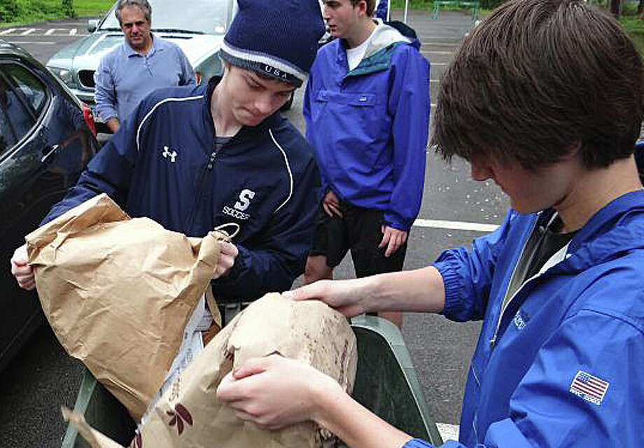 "Staples High Schools students will be on hand again Saturday -- as they were last year -- to assist with disposal of documents and records during the town's annual ""Shred Day"" from 9 a.m. to noon at 180 Bayberry Lane. Photo: File Photo / Westport News"
