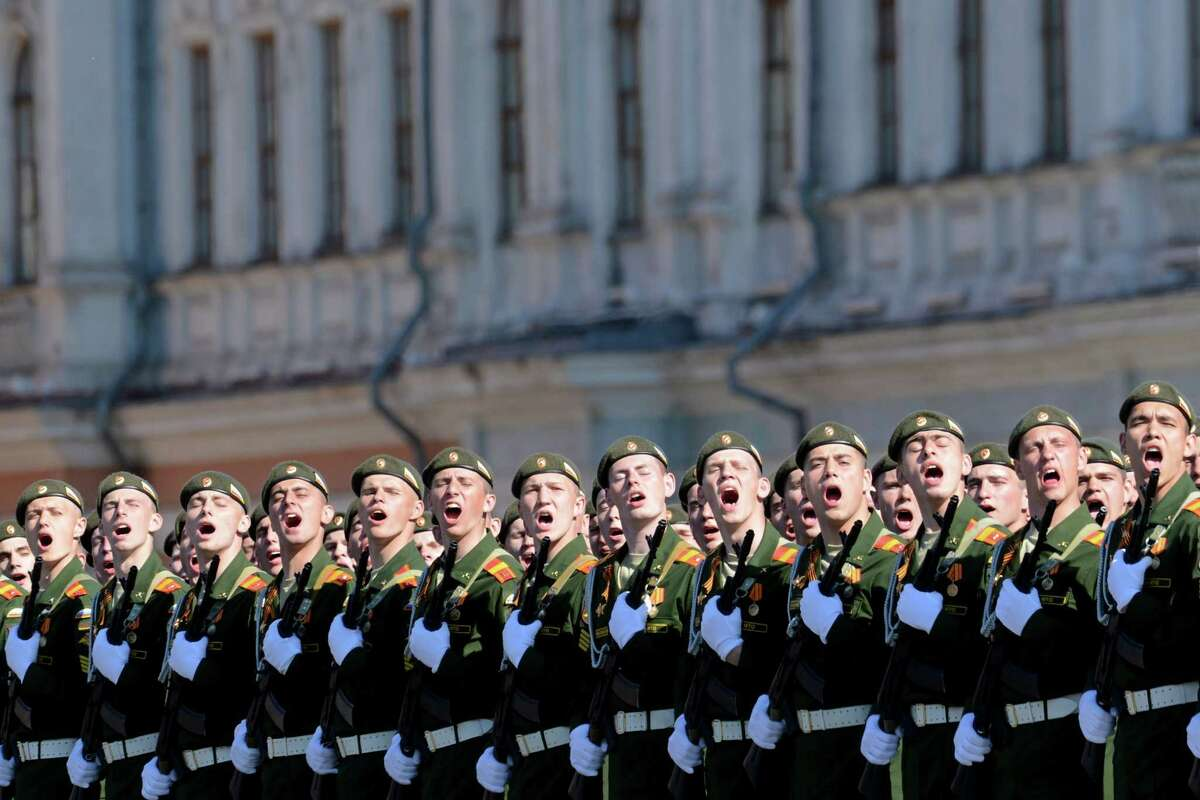 TOPSHOTS Russian military academy cadets shout at the Red Square in Moscow, on May 9, 2014, during a Victory Day parade. Thousands of Russian troops marched today in Red Square to mark 69 years since victory in World War II in a show of military might amid tensions in Ukraine following Moscow's annexation of Crimea. AFP PHOTO / KIRILL KUDRYAVTSEVKIRILL KUDRYAVTSEV/AFP/Getty Images