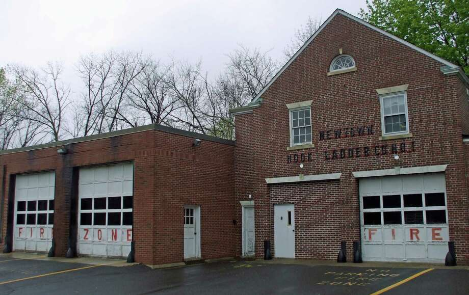 The Newtown Hook & Ladder Co. 1 is located behind Edmond Town Hall. Photo: Brian Koonz/Staff Photo, Contributed Photo / News-Times staff