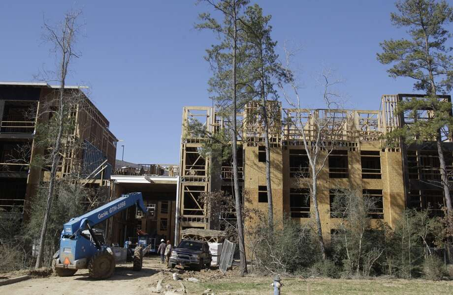 Workers do construction at the The Belvedere apartment building in the Springwoods Village master planned community Friday, Jan. 17, 2014, west of Interstate 45 in northern Harris County. ( Melissa Phillip / Houston Chronicle ) Photo: Houston Chronicle