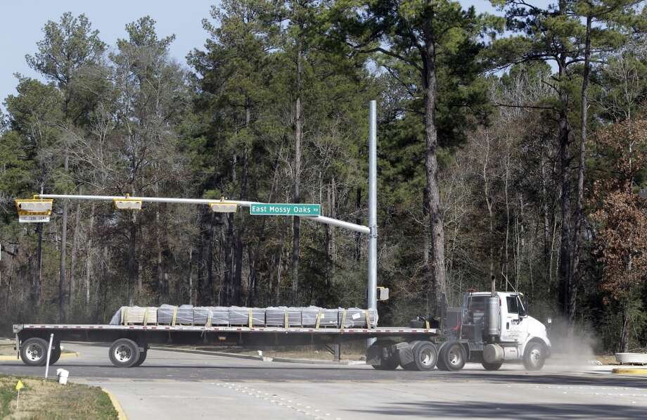 A truck loaded with construction materials moves along East Mossy Oaks Rd. in the Springwoods Village master planned community Friday, Jan. 17, 2014, west of Interstate 45 in northern Harris County. ( Melissa Phillip / Houston Chronicle ) Photo: Houston Chronicle
