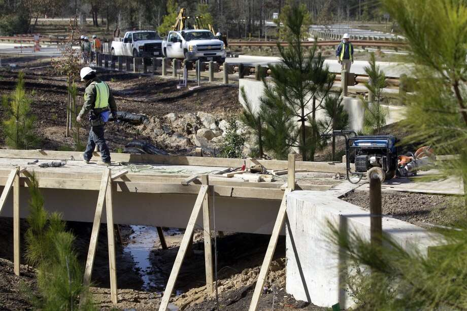 Workers do construction and landscaping along Springwoods Village Parkway in the Springwoods Village master planned community Friday, Jan. 17, 2014, west of Interstate 45 in northern Harris County. ( Melissa Phillip / Houston Chronicle ) Photo: Houston Chronicle