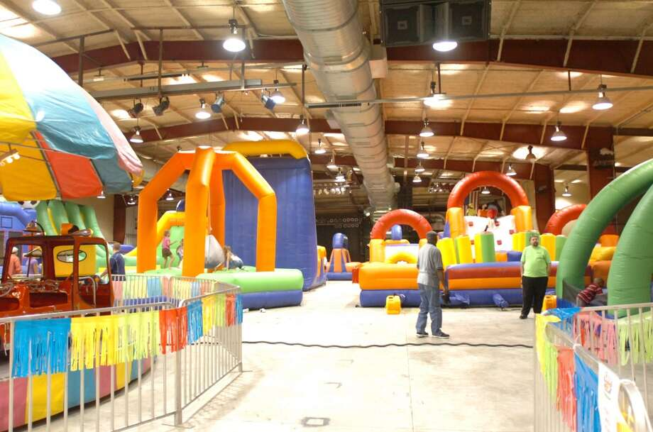 A variety of bouncers, basketball hoops, merry-go-round and other activities transform Nutty Jerry's into Elise's Play House. The indoor amusement center opens to the public next Saturday. Photo: Sarah Moore