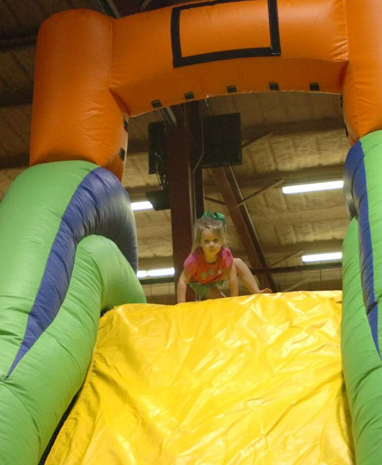 Kinslee McGalin, 3, prepares to go down a slide at Elise's Play House, a new family amusement center at Nutty Jerry's in Winnie opening to the public next Saturday. Photo: Sarah Moore