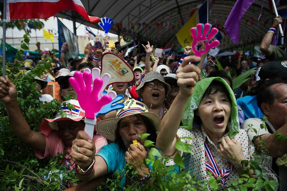 Antigovernment protesters, who launched a final mission to topple the government after the ouster of the prime minister, rally in Bangkok. Photo: Nicolas Asfouri, AFP/Getty Images