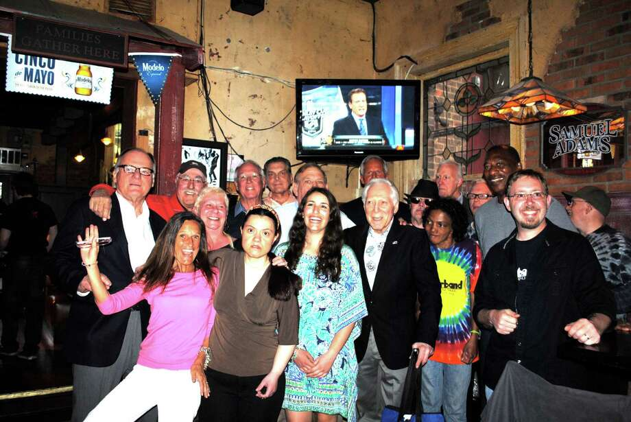 Members of the STAR Inc.'s Rubberband, NFL Alumni and Teresa Bracchitta, owner of Sundown Saloon, gather for a picture at the NFL Alumni CT Chapter's Kick-off party last week. Photo: Contributed Photo / Greenwich Time Contributed