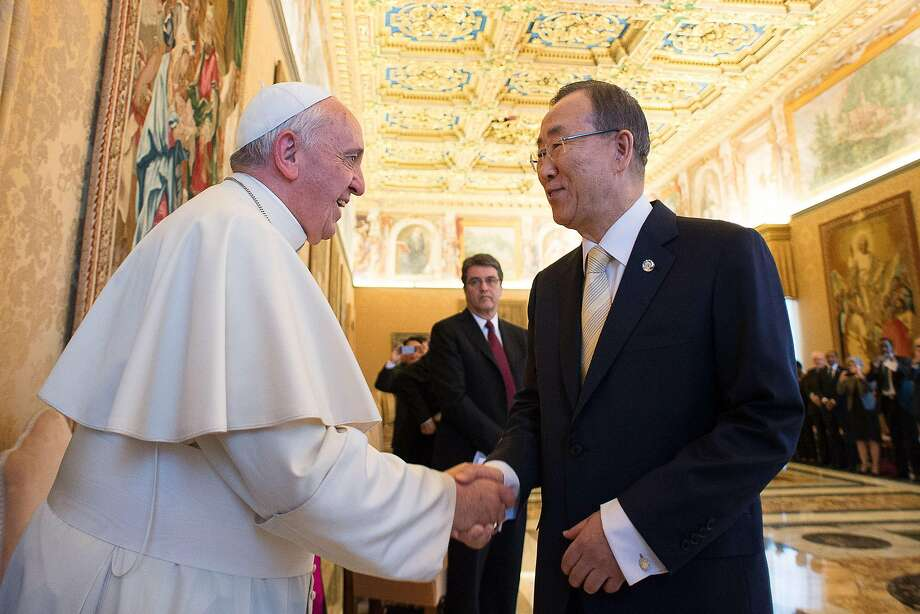 Pope Francis welcomes U.N. Secretary General Ban Ki-moon during an audience at the Vatican. Photo: -, AFP/Getty Images